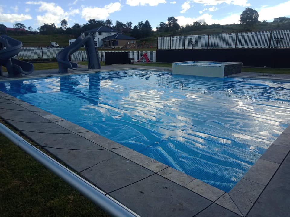 Swimming Pool Covers And Rollers